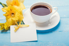 Blank paper card, yellow flowers and coffee o Stock Image