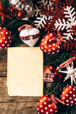 Blank paper and Christmas decoration Stock Photos