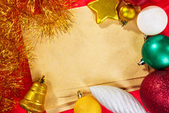 Blank paper and Christmas ornaments Stock Images