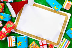 Blank paper and Christmas presents Royalty Free Stock Photography
