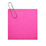 Blank paper with clip. (pink) isolated over white background Stock Image