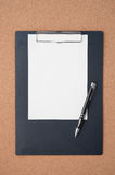 Blank Paper clipboard on corkboard  for text and background Stock Photo