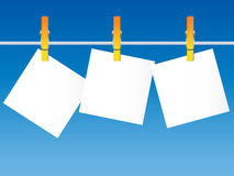 Blank paper on a clothes line Stock Images