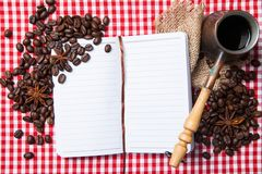 Blank paper, coffe bean and coffee cup on wood Royalty Free Stock Photo