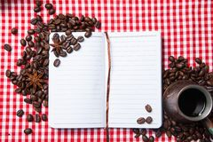 Blank paper, coffe bean and coffee cup on wood Royalty Free Stock Photos