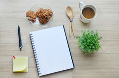 Blank paper, coffee break and office tools on the wood table - T Stock Photos