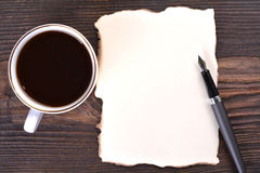 Blank paper with coffee cup and fountain pen Royalty Free Stock Images