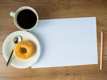 Blank paper with coffee cup and pencil and donut Stock Photo