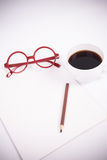 Blank paper with coffee, glasses Stock Image