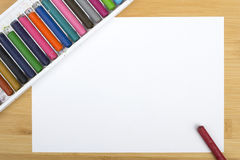 Blank paper and colorful crayons Royalty Free Stock Photos
