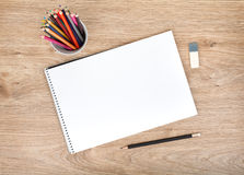 Blank paper and colorful pencils on the wooden table Royalty Free Stock Photos
