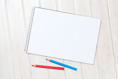Blank paper and colorful pencils on the wooden table Stock Photography