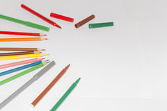 Blank paper and colorful pencils on the wooden table. View from above royalty free stock photos