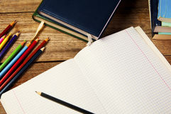 Blank paper and colorful pencils, on the wooden table. View from above. School concept. Stock Image