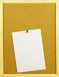 Blank paper in a corkboard Royalty Free Stock Image