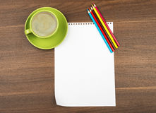Blank paper with crayons and cup of coffee Stock Images