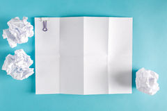 Blank paper with crumpled paper balls Royalty Free Stock Images