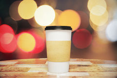 Blank paper cup of coffee on the wooden table Stock Photos