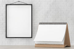Blank Paper Desk Spiral Calendar in front of Brick Wall with Frame Royalty Free Stock Image