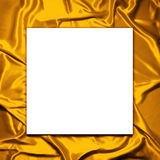 Blank paper on Elegant gold satin background Stock Photos