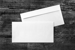 Blank paper envelopes. Blank white paper envelopes. template. Photo of blank envelopes on dark wooden background. Two envelopes. Back and front view. Template stock images
