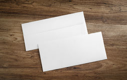 Blank paper envelopes. On wooden table background. Front and back side. Template for your design. Top view stock images