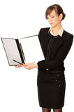Blank paper in file. The new worker holds the white blank paper in the folder and making presentation Royalty Free Stock Photography