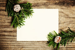 Blank Paper with Fir Branch on Wooden. Christmas Background Stock Photos