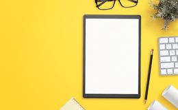Blank paper on folder on yellow office desk with copy space beside royalty free stock images