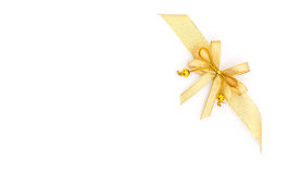 Blank paper and gold ribbon Royalty Free Stock Photography