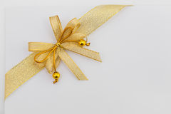 Blank paper and gold ribbon Royalty Free Stock Image