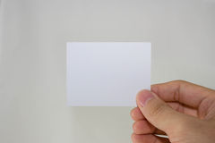 Blank paper. Hand holding blank piece of paper Stock Photography