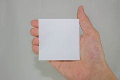 Blank paper. Hand holding blank piece of paper Stock Photos