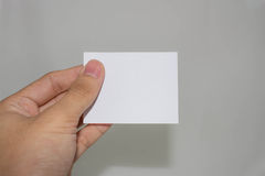 Blank paper. Hand holding blank piece of paper Stock Images