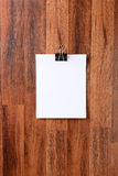 Blank Paper Hanging on Wall Royalty Free Stock Photo