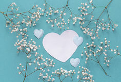 Blank paper heart-card with frame of delicate little white flowe Royalty Free Stock Images