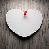Blank paper heart on wood Stock Photo