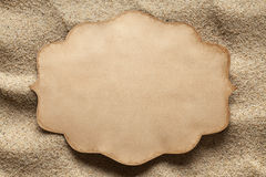 Blank paper label on the beach Stock Photography