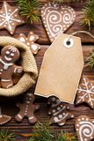 Blank paper label and gingerbread Christmas cookies royalty free stock image