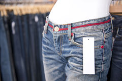 Blank paper label tag on jeans Stock Image