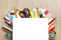 Blank paper on lots of office supplies Royalty Free Stock Photo
