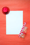Blank paper message on heart pattern background. A white blank paper with red candle, paper straws striped and milk bottle on heart pattern letter red Stock Photography