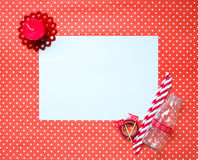 Blank paper message on heart pattern background. A white blank paper with red candle, paper straws striped and milk bottle on heart pattern letter red Stock Image