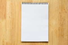 Blank paper note book on wood table. Background stock photo