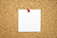 Blank paper note on cork board Stock Photo