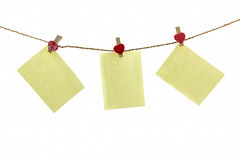 Blank paper note hanging on rope . Stock Images