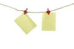 Blank paper note hanging on rope. Royalty Free Stock Images