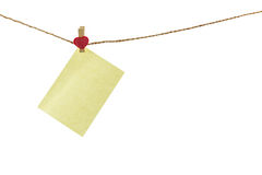 Blank paper note hanging on rope . Royalty Free Stock Image