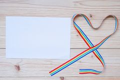 Blank paper note for LGBTQ with heart shape Rainbow ribbon for Lesbian, Gay, Bisexual, Transgender and Queer community.  stock photo