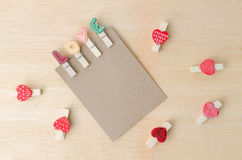 Blank paper note with love clips and red hearts on wooden backgr. Ound. Love concept Royalty Free Stock Photos